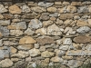 A stone wall of a village house.